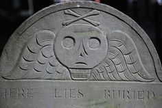 Puritan Tombstone-i love the skull and wings, which symbolize death and the eternal life after it, respectively.