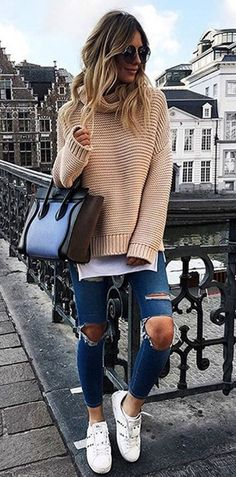Sneakers + oversized sweater + ripped jeans