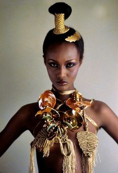 Iman in jewelry by Mary McFadden. Photo by Eisuke Ishimuro for Vogue, 1977