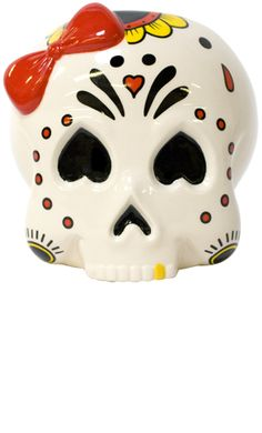 Always losing your keys, don't know where to put your spare change?! Now you have this darling sugar skull to help you out! This ceramic girly sugar skull has a hand painted red bow, black red & yellow Day of the Dead design & an opening that is perfect for storing anything your little heart desires.    $14.00