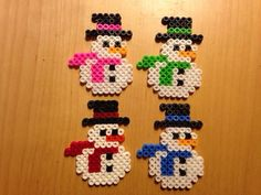 Colorful snowmen hama perler beads by Perler Bead Designs, Hama Beads Design, Diy Perler Beads, Perler Bead Art, Fuse Bead Patterns, Perler Patterns, Beading Patterns, Pixel Art Noel, Christmas Perler Beads