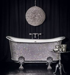 More money than sense? £150,000 bathtub studded with 22,000 Swarovski crystals goes on sale at Harrods   The all white crystals appear to give a uniform glitter, but four different types of Swarovski crystals are used to obtain the effect