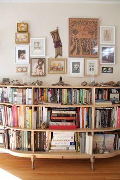 love this wall / bookshelf - lauren spencer king - via designsponge sneak peeks