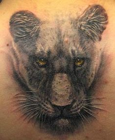 Super realistic black panther head tattoo                                                                                                                                                     More