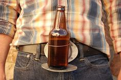 BevBuckle. Faceplate on the belt buckle folds down and a ring pops up to hold your beer.