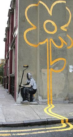 Banksy - Flower power: A double yellow line turns into a huge yellow flower - with artist 'self-portrait' - in London
