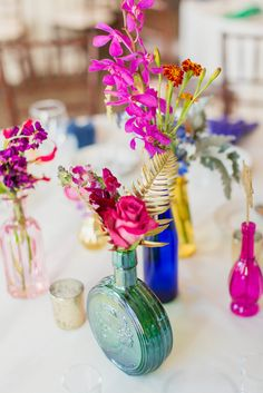 Jewel-Toned Vintage Vase Centerpieces | Stephanie Dee Photography https://www.theknot.com/marketplace/stephanie-dee-photography-alexandria-va-647681 | Soirees and Bouquets