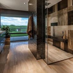Elegant Bathroom - love the design on the shower wall! And that dark brick shower wall Contemporary Shower, Contemporary Bathroom Designs, Modern Shower, Contemporary Bathtubs, Modern Contemporary, Modern Luxury, Modern Design, Zen Design, Garden Design
