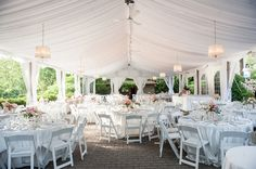 Love the subtle blush lighting Pretty Open tent wedding reception