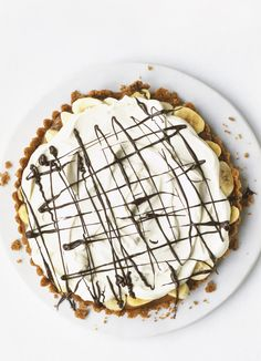 We know you love this classic olive magazine recipe - it's been one of our most popular recipes for years! Banoffee pie is a much loved family-favourite. This delicious dish is packed with banana, cream and an oaty-biscuit base, decorated with a drizzle of dark chocolate.