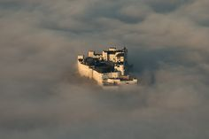 Hohensalzburg Castle, sits above picturesque Salzburg, Austria Castle In The Sky, Travel Around The World, Around The Worlds, Medieval Fortress, Surreal Photos, Above The Clouds, 10 Picture, Natural Phenomena, Weird World