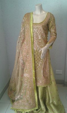 Green velvet embroidered along with naqshi and sequence completely hand made (zardozi) lehanga,Kurti and dupatta.