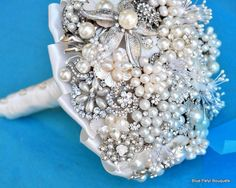 """@Celia Carter I bet we can """"dig"""" in our jewlery boxes and come up with enough pretties to make this!  Neat idea.   Pearl Brooch Bouquet by Blue Petyl #wedding #bridal #bouquet"""