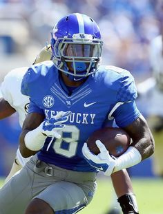 Kentucky Football - Wildcats Photos - ESPN LEXINGTON, KY - SEPTEMBER 27: Stanley Williams #18 of the Kentucky Wildcats runs with the ball during the game against the Vanderbilt Commodores at Commonwealth Stadium on September 27, 2014 in Lexington, Kentucky. (Photo by Andy Lyons/Getty Images)