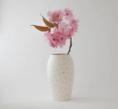 Lovely hand painted matte white ceramic vase with golden