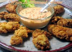 A plate of deep-fried YUM! Mississippi Style Fried Oysters with a Zingy Remoulad. A plate of deep-fried YUM! Mississippi Style Fried Oysters with a Zingy Remoulade Sauce Oyster Recipes, Cajun Recipes, Fish Recipes, Seafood Recipes, Cooking Recipes, Cajun Cooking, Cajun Food, Cooking Games, Noodle Recipes