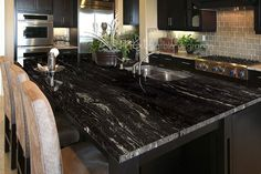 Check out this incredible Cosmic Black granite countertop! Visit Mont Surfaces and select from over 400 varieties of natural stone and quartz for your customized project!