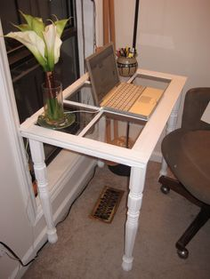 This isn't my table, but this is essentially what I designed for my next project. I have two large windows. One will be for a vanity and the other will be for my desk. I also want to make bedside tables with small windows and use old doors for a headboard.
