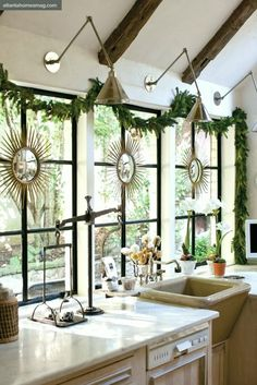 Christmas Decorating Ideas a beautiful round up of holiday decorating ideas.  All simple, elegant a nd ver little red.