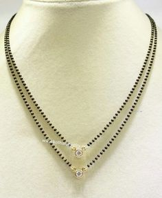 Simple two step black bead mangalsutra  with single diamond pendants