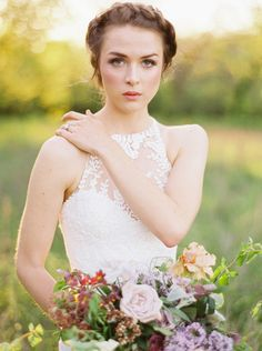 There is almost too much beauty in this shot (if that is even possible) captured by Heather Hawkins Photography! From the hair and make-up by Tracy Melton Artistry to the floral design by Bows and Arrows, to the stunning Enzoani Gown Isla!