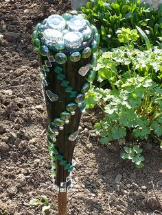 Wine bottle with mosaic stones as garden decoration | Flickr - Photo Sharing!