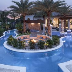 Lazy River and Sitting AreaPhoto By: Joe TrainaThis lazy river winds its graceful way around a sunken sitting area, warmed by a fire pit. Palm trees complete the luxurious oasis look. Pool House Designs, Backyard Pool Designs, Swimming Pool Designs, Luxury Swimming Pools, Luxury Pools, Dream Pools, Dream Home Design, My Dream Home, Modern House Design