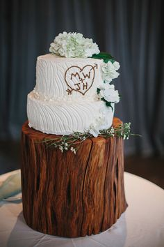 woodsy wedding cake with stump heart detail and wood trunk as cake stand // photo by Lev Kuperman http://ruffledblog.com/woodsy-hudson-valley-wedding/