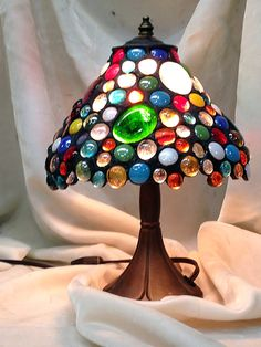 Here's Linda's beautiful completed Gem Lampshade she made in last week's Saturday workshop! A winter visitor from Canada, Linda made a point of joining us this season and we're tickled she did! Stunning, right?