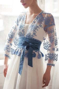 Blue embroidered white dress