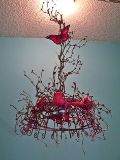 Red bird chandelier, could use a wire basket.