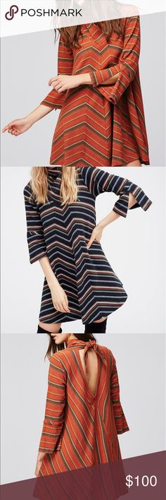 Free People Adobe Striped Mini dress Gorgeous dresses one blue and one Rust both look great on with boots a must have one each size each color Free People Dresses Mini