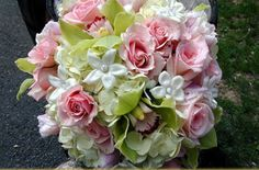 <3 Bridal bouquet inspiration <3 - Similar to this style. Use white stephanotis, contrasting shades of pink roses and tulips, and green and pink cymbidium orchids.  Leave out the white stephanotis in the bridesmaids bouquets, and have the flower girl carry white stephanotis.