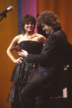 """Roseanne Cash and Ricky Skaggs perform at """"The 16th Annual CMA Awards"""" (10/11/1982)."""