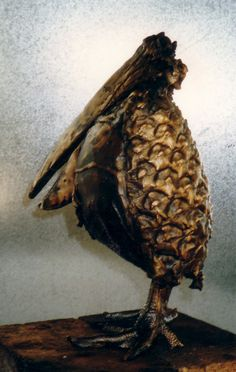 """Arne Ranslet   """"Pineapple bird""""  Bronze  Arne Ranslet experimented when he made sculptures and would use all kind of textures and fragments of different materials.This bird had real chicken legs and half a pineapple  as body. (Pharyah)"""