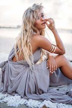 The Gown is an amazing floor-length maxi dress in grey featuring a draped style skirt which gathers at the waist and a plunge neckline. The back featured draped