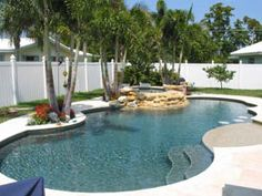 Tropical Breeze Pebble Tec in the body of the pool. The sun shelf is done in sandy beach pebble tec.