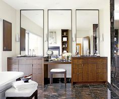 Love the vanities and mirrors in this bathroom! #bathroom #mirror #vanity