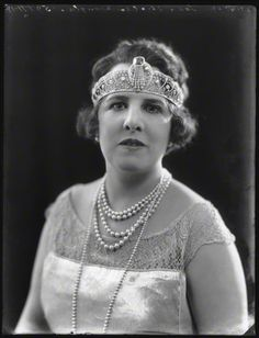 Georgina Leonora Douglas, nee Mosselmans, Marchioness of Queensbury, 1922. Wearing a rather nice at deco bandeau, with approx fourteen diamond panels flanking a central diamond motif incorporating a large sapphire and diamond spray.