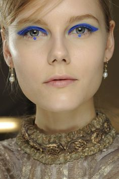 Anna Sui Bright blue winged liner with dots on the lower lash line at Anna Sui.