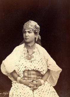 Africa | A Kabyle woman in traditional dress.  Algeria. ca. 1875 | Photographer unknown.