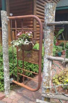 From All Things Country... an old headboard as a garden gate!!!  Love this!