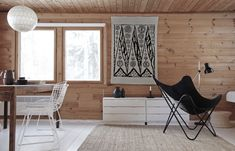 Wood, scandinavian style and wonderful black chair - see this one: http://9design.pl/product-pol-3878-Kare-design-Fotel-Butterfly.html