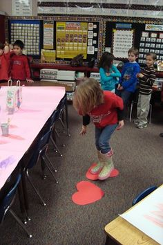 "A favorite game and not so quiet game….""Heart Lava""! They had to use two large hearts to move across the room without falling in the ""lava"". A very fun racing game!"