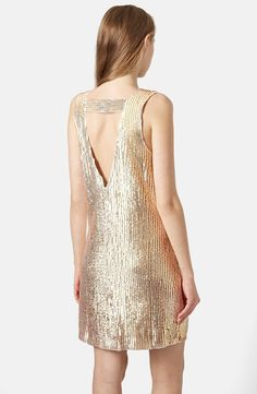 Love this gold sequin dress for new year.