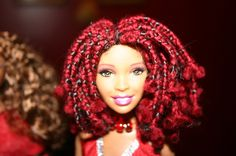 Reminds me of Janet! African American Barbie Doll - Red Yarn Braids Natural Style. $49.99, via Etsy.