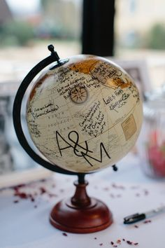 Globe wedding guest book. . Photography by Caro Weiss #wedding #guestbook