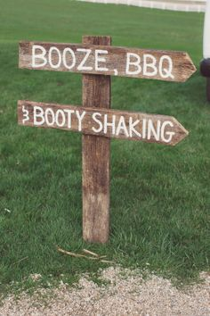 """""""Booze, BBQ, and booty shaking"""" sign made from old barn boards.  ~Signed by Soden"""