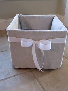 Fabric cover for cheap plastic milk crates. Nice way to dress up a storage solution! (this blog is PACKED with ideas. Check it out)