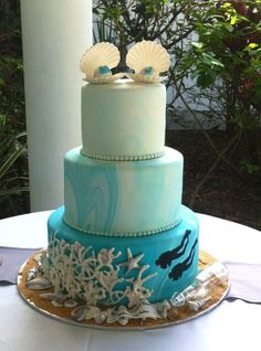 Custom Ombre ocean theme wedding cake with custom cake topper and coral reef with divers at the bottom- The Cake Zone